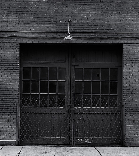Doors on an old factory in louisville photograph by for Murphy garage doors