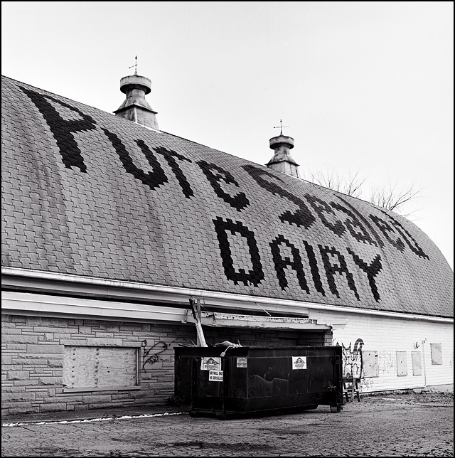 The name of the Pure Sealed Dairy spelled out on the roof of the big barn at the abandoned milk production facility in Fort Wayne, Indiana.