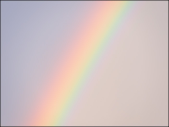 A close-up view of a rainbow in the sky on a rainy October evening in Fort Wayne, Indiana.