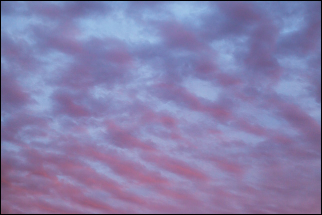 Abstract photograph of a blue sky with bands of purple clouds at sunset on a November evening in rural Allen County, Indiana.