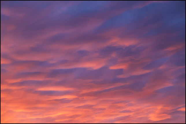 Abstract photograph of a purple sky with orange and red clouds at sunset on a November evening in rural Allen County, Indiana.