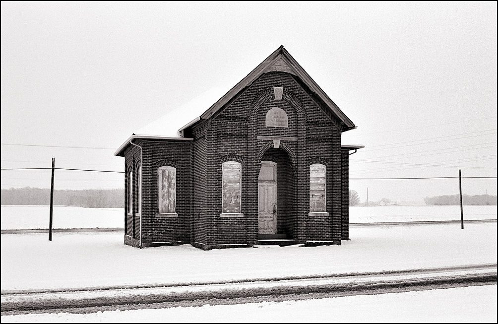Snow covers the ground around the abandoned Jefferson Township Center Schoolhouse at Besancon in Allen County, Indiana.