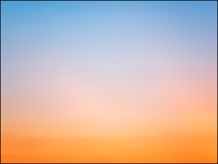 An abstract photograph of the sky transitioning from light blue at the top to deep orange at the bottom at sunset. This is in northwest rural Allen County, Indiana.