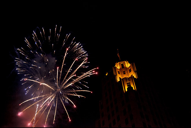 Fireworks explode next to the Lincoln Tower on the Fourth of July in Fort Wayne, Indiana.