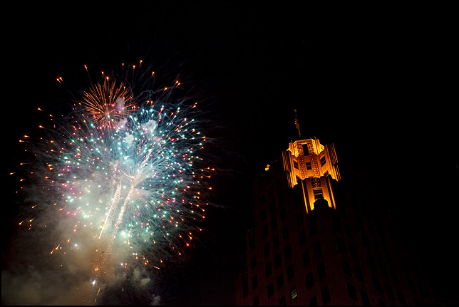 Fourth of July Fireworks light up the sky next to the Lincoln Tower in downtown Fort Wayne, Indiana.