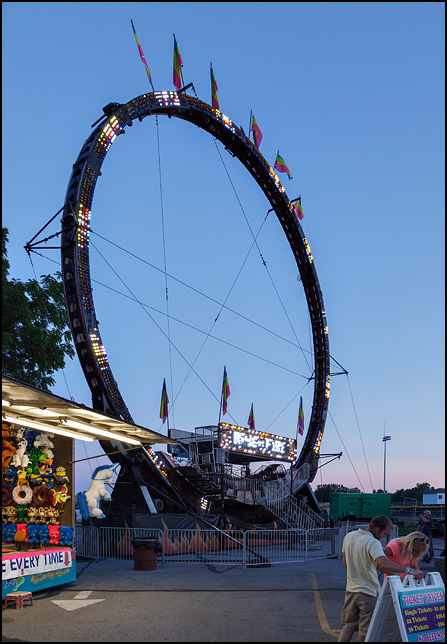 The lights on the Ring Of Fire Ride shine in the dark sky at dusk during the 2016 Churubusco Turtle Days carnival in the small town of Churubusco, Indiana.