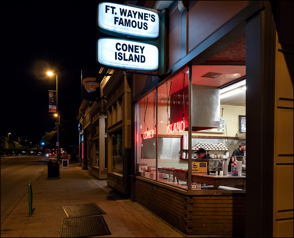 Looking in the front windows of Fort Wayne's Famous Coney Island Hot Dog Stand at closing time. Workers are cleaning the grills.