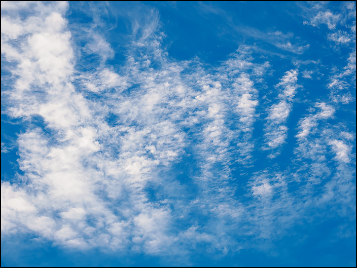 Abstract photograph of white clouds in a blue sky over Fort Wayne, Indiana.