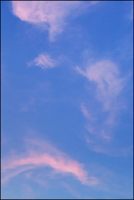 Abstract image of clouds that look like a sad face in the sky over Fort Wayne, Indiana.