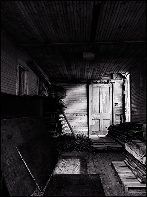 Wood stacked inside the back room of an abandoned farmhouse in Indiana.