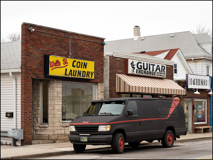 A van painted to look like the van driven by the A-Team is parked on the street in front of Wells Street Coin Laundry on Wells Street in Fort Wayne, Indiana.