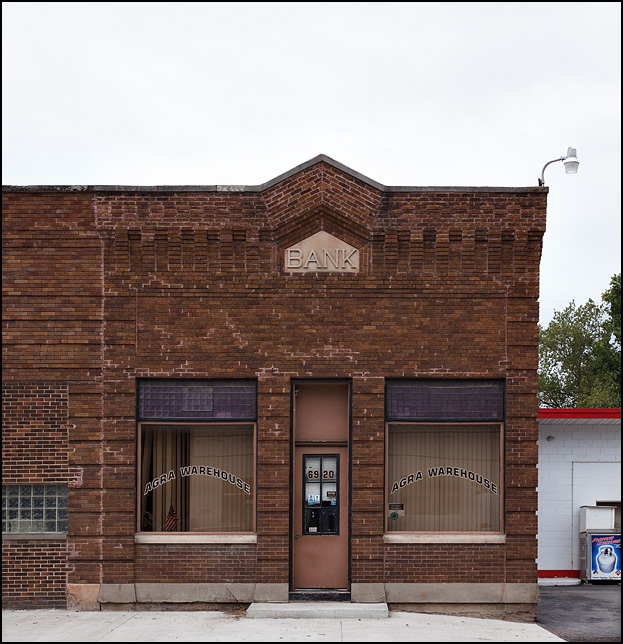 An old brick bank building on State Road 1 in the small town of Spencerville, Indiana. The building is now a business called Agra Warehouse.