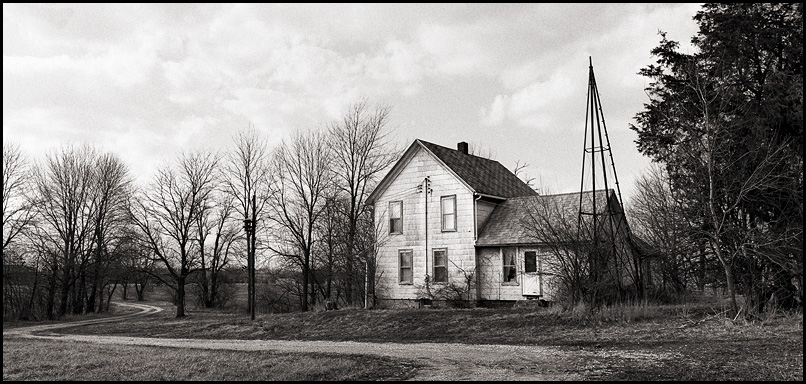 An abandoned farmhouse with a long winding driveway along the Airport Expressway in southwest Allen County, Indiana.