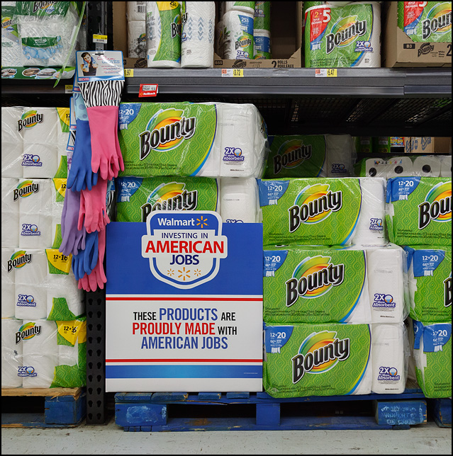 A display of Bounty Paper Towels at a Walmart store that says, Walmart Investing in American Jobs. These products proudly made with American jobs.
