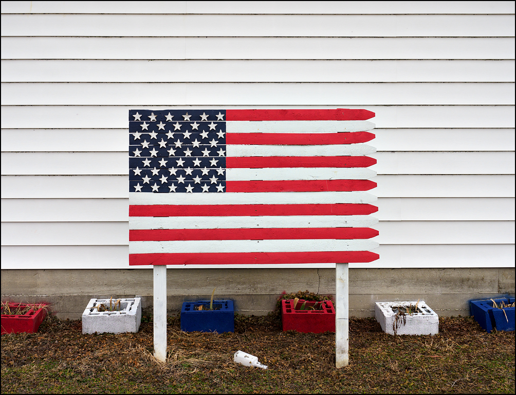 A hand-painted American flag on a piece of wooden stockage fence in the small town of Andrews, Indiana.