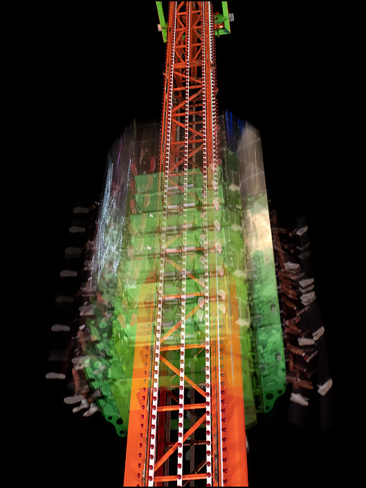 The Atmos-Fear ride at the 2019 Three Rivers Festival in Fort Wayne, Indiana. The ride is dropping down a tall tower under flashing strobe lights that give the photograph a stop-motion effect.
