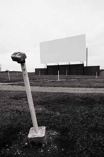 The screen and a speaker stand at the Auburn-Garrett Drive-In theater in Dekalb County, Indiana.