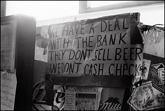 "The sign by the door at Mary's Bar in Cerrillos, New Mexico says ""We have a deal with the bank. They don't sell beer. We don't cash checks."""