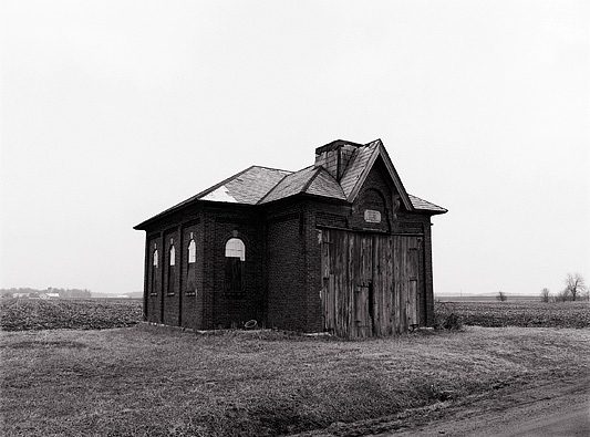 An abandoned brick one-room schoolhouse on Barkley Road in southeast Allen County, Indiana. The front of the building has been replaced with a barn door.