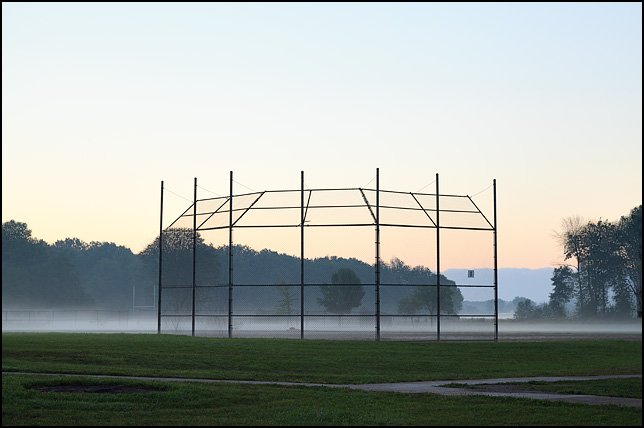 Early morning fog on the baseball field at a school in the Waynedale area of Fort Wayne, Indiana.