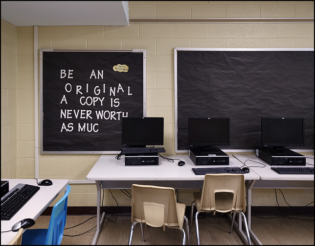 A bulletin board in a middle school computer lab that says, Be An Original A Copy Is Never Worth As Much.