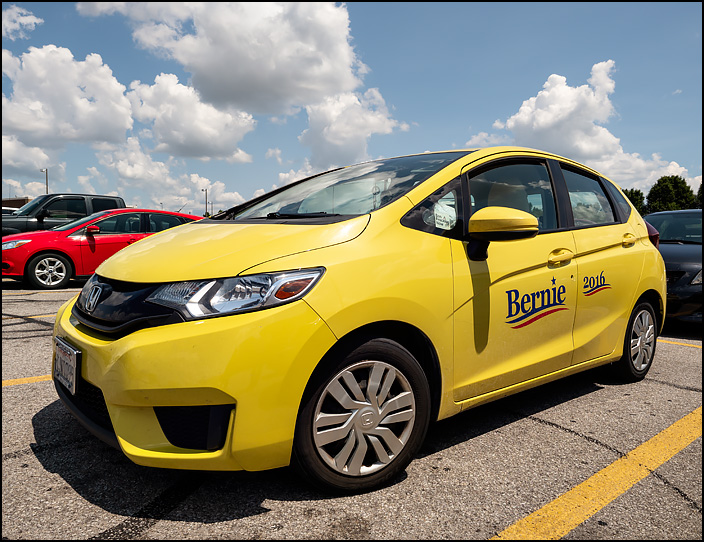 A car with Bernie 2016 painted on the side of it. The yellow Honda Fit was in the parking lot of a Barnes and Noble in Fort Wayne, Indiana.