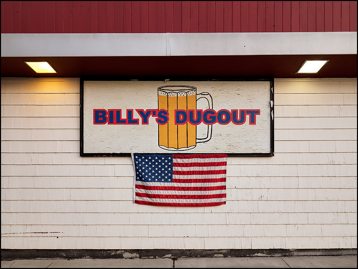 An American flag hangs on the side of Billys Dugout, a sports bar on Fairfield Avenue in Fort Wayne, Indiana.