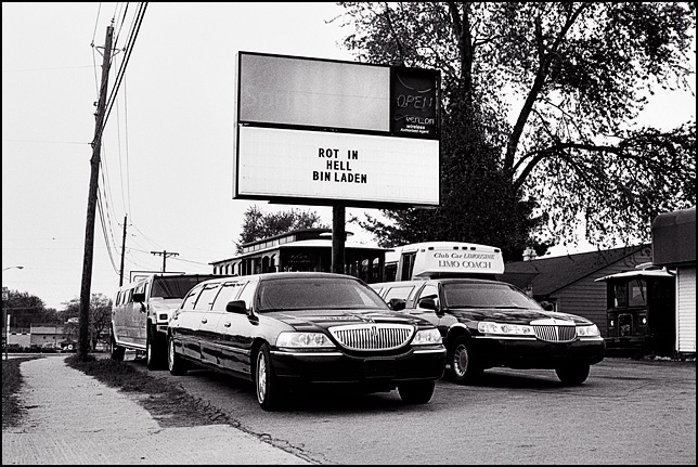 "A sign that says ""Rot in Hell Bin Laden"" in front of a business in Fort Wayne, Indiana. It is surrounded by cars belonging to the limousine service that put up the sign."