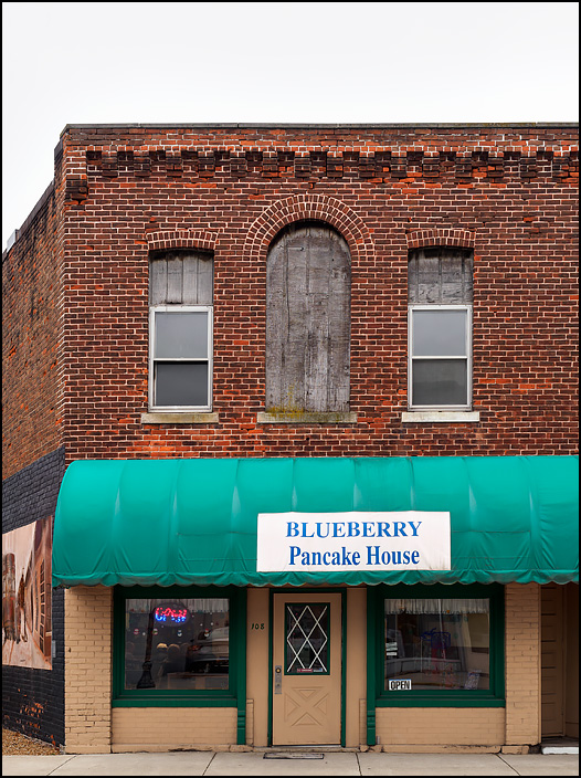 Blueberry Pancake House is a restaurant in an old brick storefront building on South Street in the small town of Monroeville, Indiana.The second floor windows are boarded up with weathered plywood.