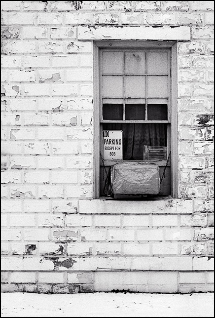 No Parking Except For Bob, a sign in the window of Burrows Insurance Agency in the small town of Mexico, Indiana.