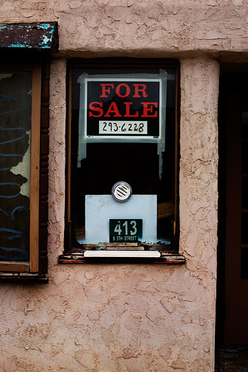 A For Sale sign hangs in the box office window of the abandoned Starr Theater in the small town of Estancia, New Mexico.