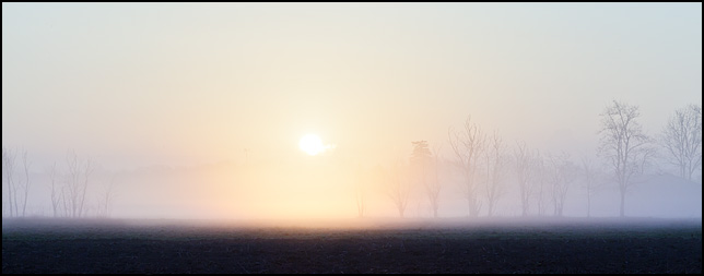 Sunrise over a foggy field on a farm on Bruick Road in Allen County, Indiana.