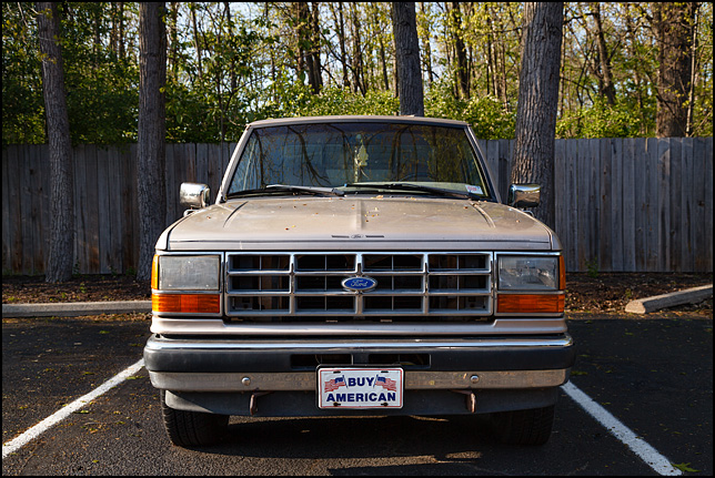 A Ford Ranger pickup truck with a license plate that says Buy American.