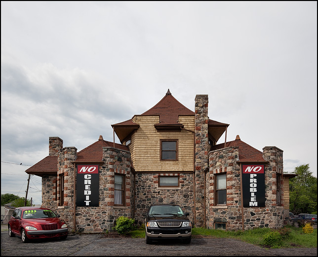 A used car dealer in an old 19th Century house that looks like a castle on State Road 930 in New Haven, Indiana.