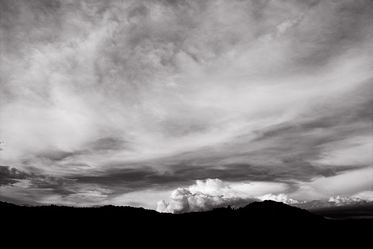 Mountains in New Mexico silhouetted against a dramatic sunset.