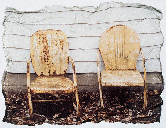 Polaroid emulsion transfer photograph of two yellow motel chairs next to my grandfather's old house.