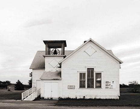 Lawton Christian Church, an old white wood-frame building with an old steeple bell in rural Pulaski County, Indiana.