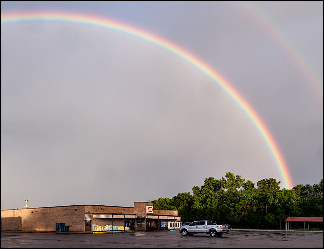 A large double rainbow over the Egolfs IGA Supermarket in the small town of Churubusco, Indiana.