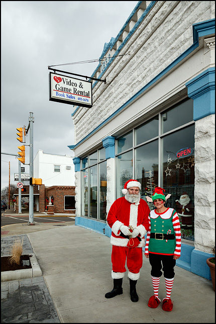 Santa Claus and an elf in front of K&K Video in the small town of Churubusco, Indiana.