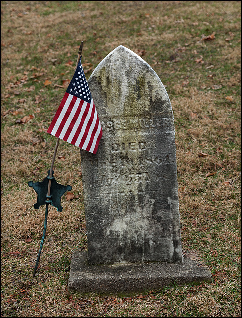 An American flag adorns the weathered tombstone of a man who died while serving in the Union Army during the Civil War. The soldier is buried at Pletcher Cemetery, a 19th century graveyard in the small town of Wakarusa, Indiana.