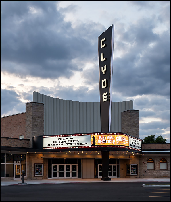 The historic Clyde Theatre on Bluffton Road in Fort Wayne, Indiana. Photographed at sunset with the restored sign and marque lit up brightly.