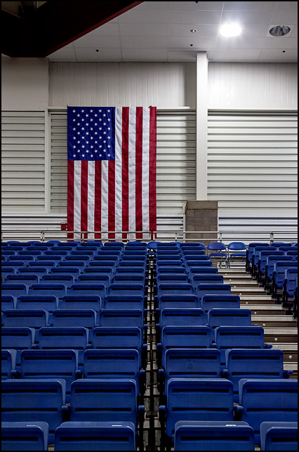 An American flag hangs on the wall above the empty stands in the Allen County War Memorial Coliseum Expo Center in Fort Wayne, Indiana.