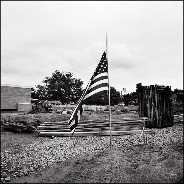An American flag at an urban construction site.