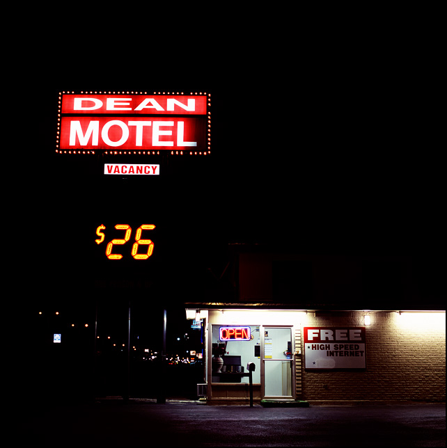 The neon lights glow in the dark night on the Dean Motel on old Route 66 and Interstate 40 on the east side of Amarillo, Texas.