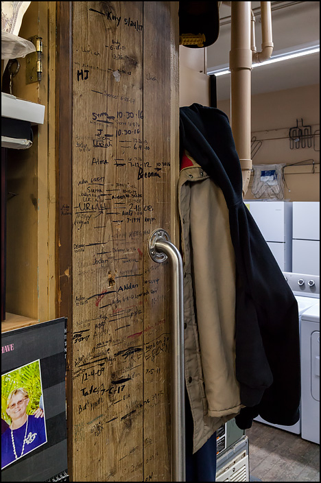 A growth chart for children drawn in a door frame at DeWeese Appliances in the small town of Warren, Indiana.