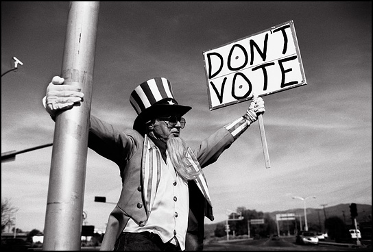 "A peace activist dressed as Uncle Sam holds a sign that says ""Don't Vote"" during an antiwar demonstration a few days before the November election in Santa Fe, New Mexico."