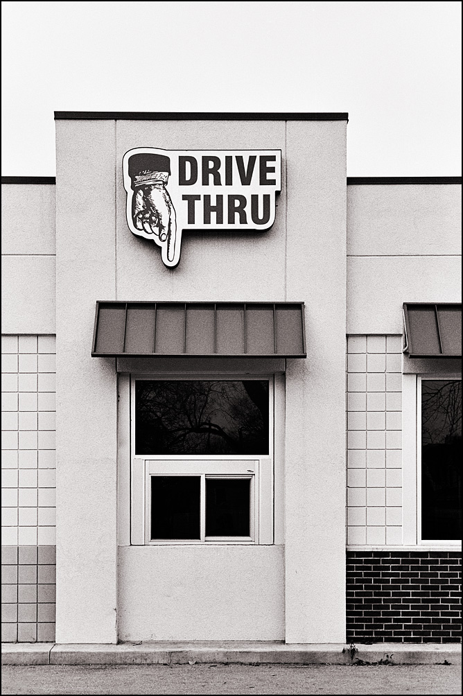Giant hand pointing down at the Drive-Thru window of a restaurant on West Main Street in Fort Wayne, Indiana.