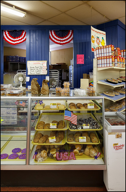 American flag decals adorn the glass display case full of cookies at the bakery in Egolf's IGA supermarket in Churubusco, Indiana.