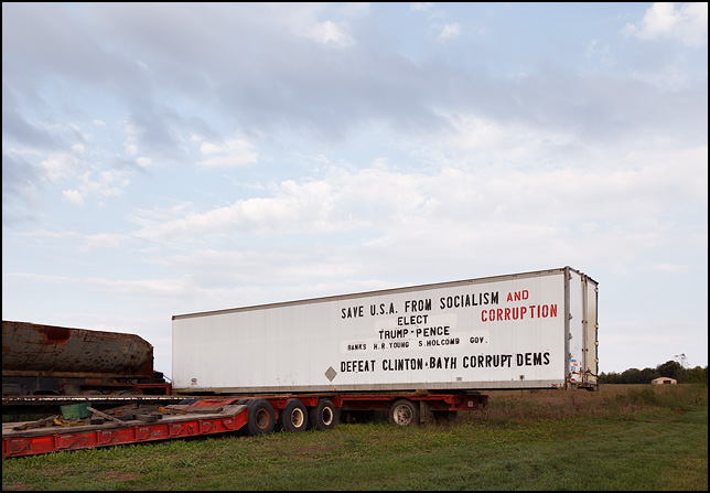 An old semi trailer with a political message stenciled on the side. Save USA from socialism and corruption. Elect Trump and Pence. Defeat Clinton. It is on US-33 near Wolf Lake, Indiana.
