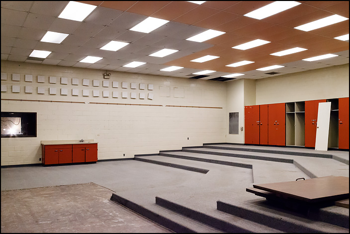 The band room at Elmhurst High School in Fort Wayne, Indiana. The room is empty, without any furniture or musical instruments because the school is closed pending demolition.